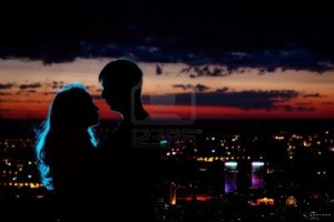 10440721-young-couple-silhouette-hugging-and-looking-at-each-other-outdoors-at-night-neon-city-backgroundaa